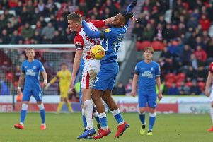 Ivan Toney of Peterborough United battles with James Morris of Doncaster Rovers. Picture: Joe Dent