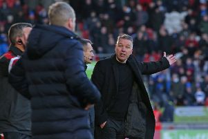 Posh boss Darren Ferguson appears not to be happy with Doncaster manager Grant McCann after the home side's controversial third goal. Photo: Joe Dent/theposh.com.