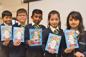 Lime Academy Abbotsmede pupils Vedant Bishwokarma, Sameer Akbari, Vatneesan Jeyanthiran, Mahsa Alizadeh and Inaayah Ali who have has their stories published  in a Young Writers short story book. EMN-190202-222821009