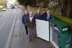 From left, Cllr Phil King from Harborough District Council, and Cllr Philip Bothwell, Cllr John Tillotson, Cllr Vijay Chavda and Cllr Kevin Feltham from Kibworth Harcourt Parish Council with the new air quality monitor