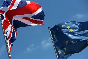 A British Union Jack and European Union flag fly. SUS-190124-085814001