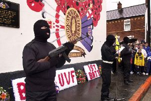 July 2000: Members of the UVF (which killed over 500 people during the Troubles) on the Shankill Road