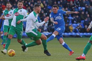 Lee Tomlin should return for Posh at Oxford.