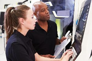 Female Apprentice Working With Engineer On CNC Machinery SUS-180515-101719001