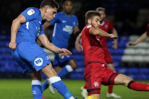 Mathew Stevens (blue) in action for Posh against Walsall in December.