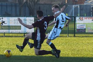 Sam Wilson scores for Peterborough Northern Star (stripes) against Holbeach United. Photo: Chantelle McDonald. @cmcdphotos.