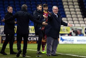 Posh manager Steve Evans appeals for a decision during a game against Bradford City.
