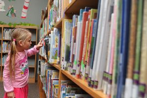 Can you become a reading buddy at a Peterborough school?