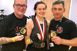 Phoebe Griffiths-Johnson with her Bognor coaches