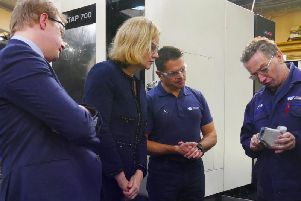 Work and Pensions Secretary Amber Rudd meets staff at Westcombe Engineering in Peterborough.