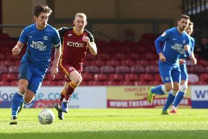 Alex Woodyard of Peterborough United in action with Lewis O'Brien of Bradford City. Picture: Joe Dent