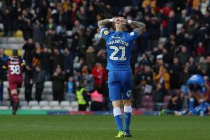 Marcus Maddison puts his head in his hands after Bradford City go 2-0 up against Posh. Photo: Joe Dent/theposh.com.