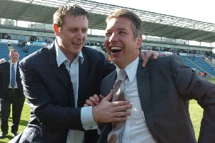 Chairman Darragh MacAnthony (left) and manager Darren Ferguson celebrate a Posh promotion.