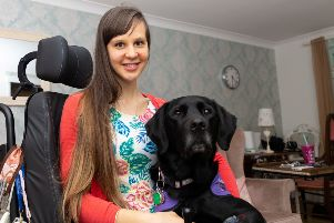 Sally Whitney with her assistance dog Ethan. Picture: Paul Davey / SWNS