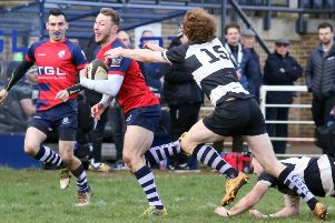 Banbury Bulls' Dan Brady is tackled by Stratford Upon Avon's  Joe Cook. Photo: Steve Prouse