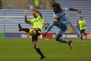 Marcus Maddison in action for Posh at Coventry in November.