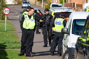 Armed police in Wisbech this afternoon. Photo: Terry Harris