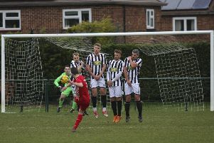 Action from Peterborough Northern Star (stripes) 0, Rothwell Corinthians 1. Photo: Tim Symonds.