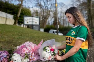Eboney Johnston, 16, leaving floral tributes at The Greenvale Hotel in Cookstown, Co. Tyrone, in Northern Ireland