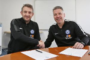 Darren Ferguson (right) and Gavin Strachan shake hands after signing their new Posh contracts. Photo: Joe Dent/theposh.com.