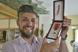 Eye restaurant owner Damian Wawrzyniak with his Knight's Cross medal.