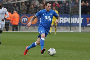 Lee Tomlin in action for Posh.
