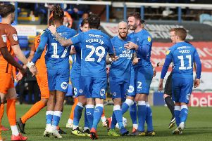 Marcus Maddison of Peterborough United celebrates scoring his side's opening goal. Picture: Joe Dent