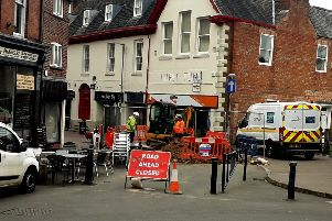 Workmen continue to work on the collapsed sewer which caused a sinkhole to open in King Street in Melton EMN-190326-133353001