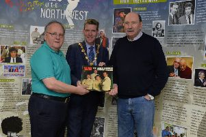 Ivor  Doherty, on the left, and Johnny Moore, exhibition creator, pictured with Councillor John Boyle, Mayor of Derry City and Strabane at the recent launch the Showbands of the North West exhibition in Aras Cholmcille Heritage Centre.  DER1319GS-048