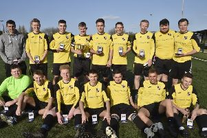 Benwick Athletic with their Europa League trophy and medals.