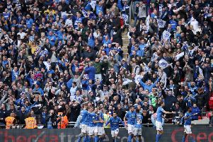 Portsmouth fans celebrate a goal in the Checkatrade Trophy FInal at Wembley.