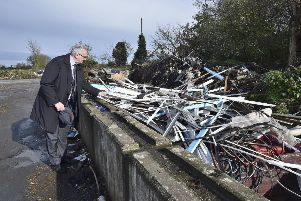Cllr John Holdich surveys some of the fly-tipping at Norwood Lane