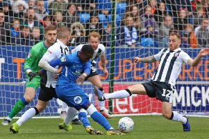 Siriki Dembele of Peterborough United is fouled by Dean Parrett of Gillingham to win a penalty. Photo: Joe Dent/theposh.com.