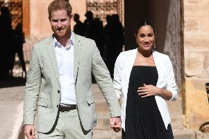Prince Harry and Meghan walk through the walled public Andalusian Gardens in Rabat, Morocco on February 25.  (Photo by Facundo Arrizabalaga - Pool/Getty Images)