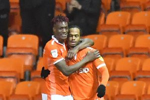 Blackpool top scorer Armand Gnanduillet (left) with teammate Nathan Delfouneso.