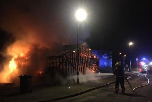 The building fire being tackled by firefighters. Photo: Cambridgeshire Fire and Rescue Service