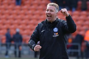 Peterborough United Manager Darren Ferguson celebrates the victory at Blackpool at full-time. Photo: Joe Dent/theposh.com.