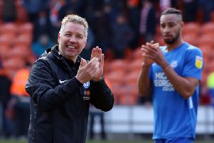 Posh manager Darren Ferguson and centre-back Rhys Bennett applaud the visiting fans after the 1-0 win at Blackpool. Photo: Joe Dent/theposh.com.