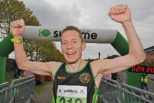 Ty Farrer celebrates his win in the Peterborough Marathon. Photo: David Lowndes.