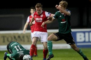 St Patricks Athletic's Simon Madden tussles with Derry City's Greg Sloggett, during their encounter at Richmond Park.