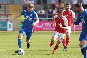 Posh centre-back Josh Knight on the ball against Fleetwood. Photo: Joe Dent/theposh.com.