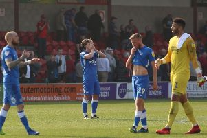 Posh players are dismayed after conceding a late equaliser at Fleetwood. Photo: Joe Dent/theposh.com.