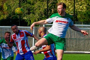Jimmy Wild gets up well for Bognor at Dorking / Picture by Tommy McMillan