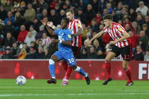 Siriki Dembel in action for Posh at Sunderland earlier this season.