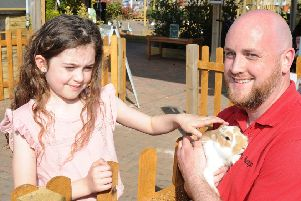 Van Hage garden centre, Eye opening of their mini farm. Store manager  Luke Hopkins with rabbits and  Lyla Graves (7) EMN-190420-144352009