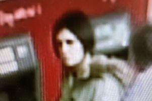 CCTV image of the 'hugging scammer', released by Sussex Police