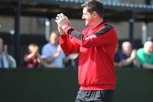 Boss Marcus Law applauds the travelling fans after Kettering Town secured a 1-0 win at local rivals AFC Rushden & Diamonds. Pictures by Peter Short