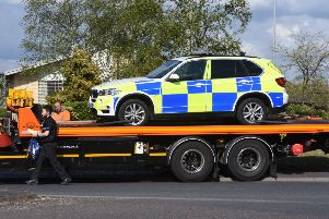A police car being recovered