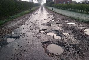 The city council is asking people to report potholes