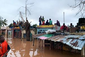 People sheltering on roofs in Mozambique